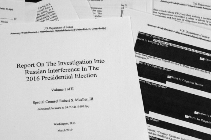 FILE - In this April 18, 2019, file photo, special counsel Robert Mueller's redacted report on Russian interference in the 2016 presidential election is photographed in Washington. The Mueller Report is no longer just a book or a document to read online. It is a work of theater and other art forms, and a touchstone for Trump opponents seeking to highlight the president's alleged misconduct, including attempts to impede or halt the Russia investigation. (AP Photo/Jon Elswick, File)