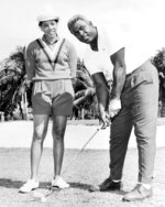 FILE - In this Feb. 23, 1962 file photo shows  Althea Gibson, former amateur tennis champion, and Jackie Robinson at the North-South Tournament at the Miami Springs course. When the US Open begins this week, she will have a statue unveiled in her honor. Says tennis great Billie Jean King: