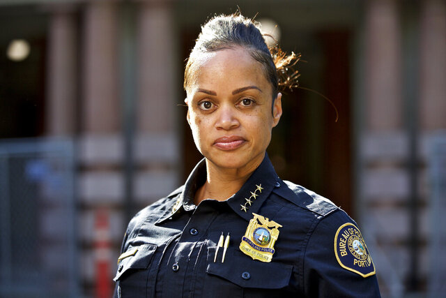 FILE - In this Aug. 5, 2019, file photo, Portland Police Chief Danielle Outlaw poses for a photo in Portland, Ore. Outlaw was named  the new Philadelphia police commissioner (AP Photo/Craig Mitchelldyer, File)