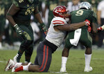 FILE - In this Oct. 28, 2017, file photo, Houston defensive tackle Ed Oliver (10) sacks South Florida quarterback Quinton Flowers (9) during the second half of an NCAA college football game, in Tampa, Fla. Oliver is a possible pick in the 2019 NFL Draft. (AP Photo/Chris O'Meara, File)