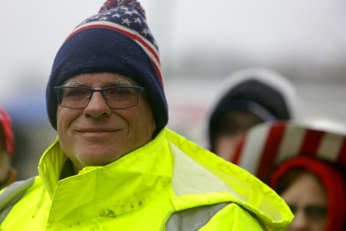 Robert Reed, 66, stands in line to attend a campaign rally with President Donald Trump at Lancaster Airport, Monday, Oct. 26, 2020 in Lititz, Pa. (AP Photo/Jacqueline Larma)