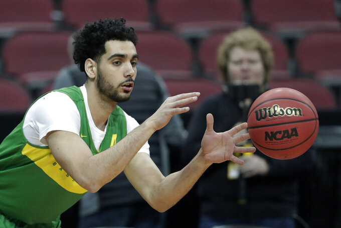 Oregon's Ehab Amin catches a pass during practice for the NCAA men's college basketball tournament, Wednesday, March 27, 2019, in Louisville, Ky. (AP Photo/Michael Conroy)