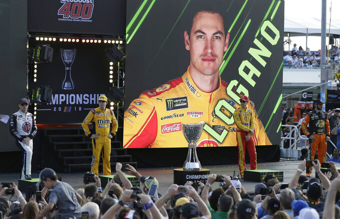 Kevin Harvick, left, Kyle Busch, Joey Logano, and Martin Truex Jr., right, are introduced before a NASCAR Cup Series Championship auto race at the Homestead-Miami Speedway, Sunday, Nov. 18, 2018, in Homestead, Fla. (AP Photo/Terry Renna)