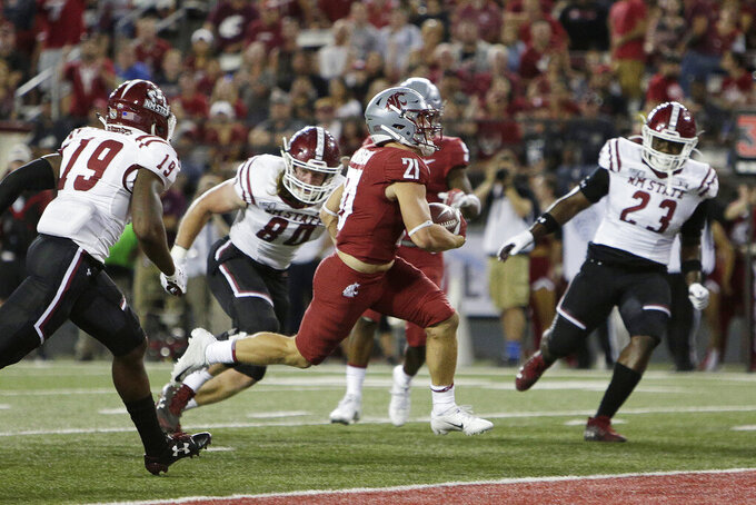 Washington State running back Max Borghi (21) runs for a touchdown while pursued by New Mexico State defensive back Austin Perkins (19), linebacker Trevor Brohard (80) and linebacker Rashie Hodge Jr. (23) during the first half of an NCAA college football game in Pullman, Wash., Saturday, Aug. 31, 2019. (AP Photo/Young Kwak)