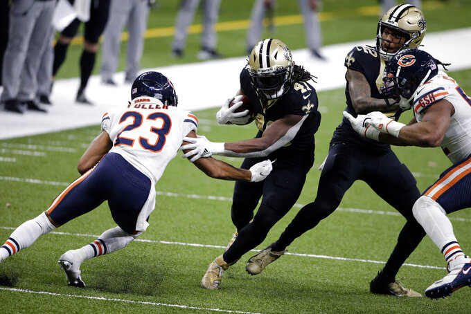 New Orleans Saints running back Alvin Kamara (41) carries against Chicago Bears cornerback Kyle Fuller (23) in the second half of an NFL wild-card playoff football game in New Orleans, Sunday, Jan. 10, 2021. (AP Photo/Butch Dill)