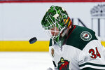 Minnesota Wild goaltender Kaapo Kahkonen makes a save against the Arizona Coyotes during the second period of an NHL hockey game Friday, March 5, 2021, in Glendale, Ariz. (AP Photo/Rick Scuteri)