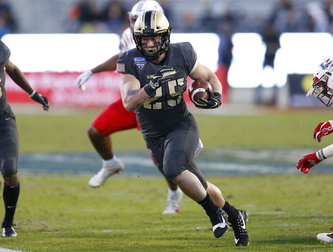 Army running back Connor Slomka (25) rushes against Houston during the second half of Armed Forces Bowl NCAA college football game Saturday, Dec. 22, 2018, in Fort Worth, Texas. (AP Photo/Jim Cowsert)