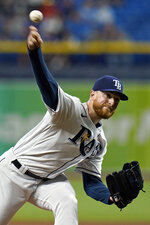 Tampa Bay Rays' Drew Rasmussen pitches to the Toronto Blue Jays during the first inning of a baseball game Tuesday, Sept. 21, 2021, in St. Petersburg, Fla. (AP Photo/Chris O'Meara)