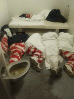 This undated photo taken by an inmate at Mississippi State Penitentiary at Parchman and provided to The Associated Press shows inmates seen lying on the floor next to a full toilet. After violence at the prison on Jan. 2, 2020, guards and state troopers marched some prisoners at Parchman into Unit 32, a cell block closed in 2011 as part of a settlement; the inmate says the unit has no running water or mattresses, and is plagued by mold and issues. (Courtesy photo via AP)