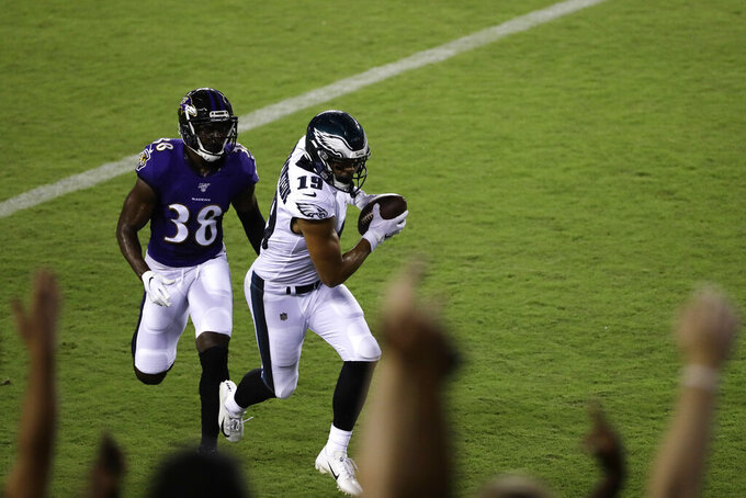 Philadelphia Eagles' JJ Arcega-Whiteside (19) scores a touchdown past Baltimore Ravens' Stanley Jean-Baptiste (38) during the second half of a preseason NFL football game Thursday, Aug. 22, 2019, in Philadelphia. (AP Photo/Michael Perez)