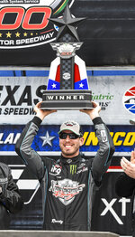Driver Kyle Busch celebrates in victory lane after winning a NASCAR auto race at Texas Motor Speedway, Saturday, March 30, 2019, in Fort Worth, Texas. (AP Photo/Larry Papke)