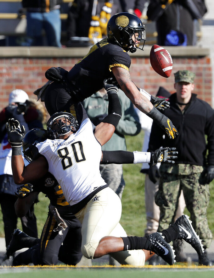 Missouri safety Cam Hilton, top, breaks up a pass intended for Vanderbilt tight end Jared Pinkney in the end zone on the final play of an NCAA college football game Saturday, Nov. 10, 2018, in Columbia, Mo. Missouri won 33-28. (AP Photo/Jeff Roberson)