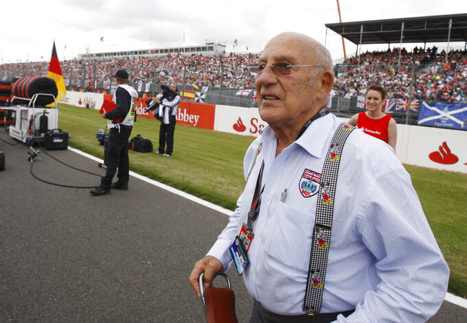 FILE - In this file photo dated Sunday, June 21 2009, Stirling Moss, the legendary British Racing driver attends the British Formula One Grand Prix at the Silverstone racetrack, in Silverstone, England.  Stirling Moss has died at the age of 90, according to an announcement Sunday April 12, 2020, from his family. (AP Photo/Luca Bruno, FILE)