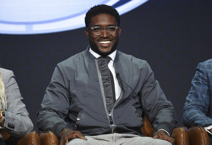"FILE - In this Aug. 7, 2019, file photo, Reggie Bush participates in Fox Sports' ""Rallying Fans for the Biggest Season in Sports"" panel at the Television Critics Association Summer Press Tour  in Beverly Hills, Calif. The former star running back had been prohibited from interacting in an official capacity with the school he played for from 2003-05 since NCAA sanctions handed down in 2010. Bush and USC were penalized for him and his family receiving impermissible benefits while he was still in school. USC President Carol Folt wrote in a letter to Bush on Wednesday, June 10, 2020, that he could now ""be afforded the privileges and courtesies extended to all Trojan football alums."" (Photo by Chris Pizzello/Invision/AP, File)"
