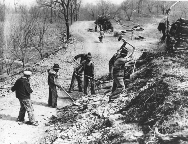 FILE - In this March 9, 1936, file photo Works Progress Administration (WPA) workers build a new farm-to-market road along Knob Creek in Tennessee. The New Deal was a try-anything moment during the Great Depression that remade the role of the federal government in American life. (AP Photo, File)