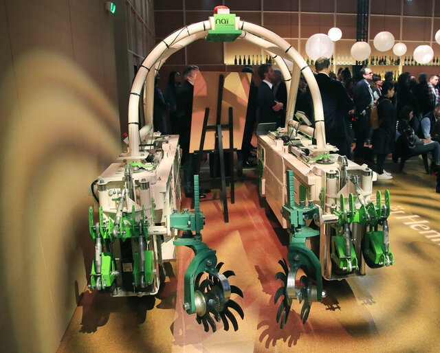 A weeding root machine is displayed at the wine fair in Paris, Monday, Feb. 10, 2020. Two thousand winemakers - including giant Moet-Hennessy - are wooing some 30,000 French and international visitors at the Vinexpo fair through Wednesday with a renewed focus on ecology and sustainability as well as tech innovation like robots. (AP Photo/Michel Euler)