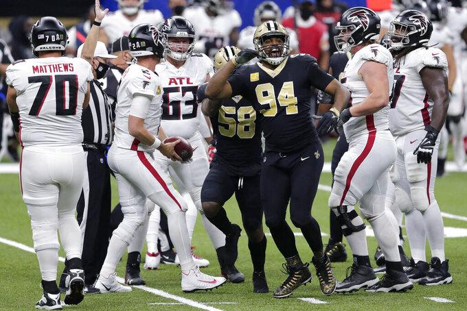 New Orleans Saints defensive end Cameron Jordan (94) celebrates his sack of Atlanta Falcons quarterback Matt Ryan (2) in the first half of an NFL football game in New Orleans, Sunday, Nov. 22, 2020. (AP Photo/Brett Duke)