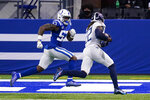 Tennessee Titans running back Derrick Henry (22) runs in for a touchdown past Indianapolis Colts outside linebacker Darius Leonard (53) in the first half of an NFL football game in Indianapolis, Sunday, Nov. 29, 2020. (AP Photo/Darron Cummings)