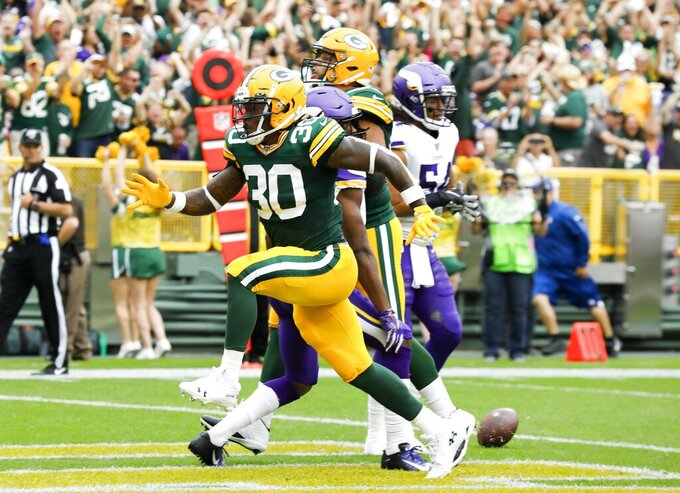 Green Bay Packers' Jamaal Williams celebrates his touchdown during the first half of an NFL football game against the Minnesota Vikings Sunday, Sept. 15, 2019, in Green Bay, Wis. (AP Photo/Mike Roemer)