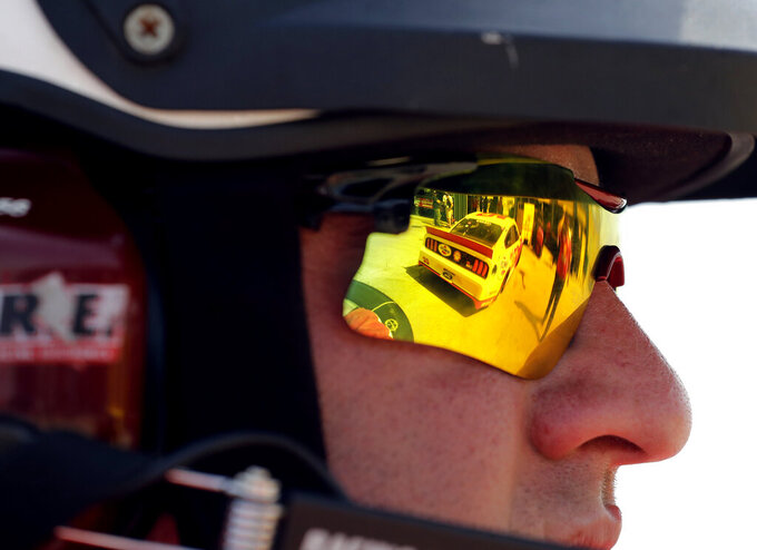 A member of Chicagoland speedway Fire Safety, watches a practice for the NASCAR Sprint Cup Series auto race at Chicagoland Speedway in Joliet, Ill., Saturday, June 29, 2018. (AP Photo/Nam Y. Huh)