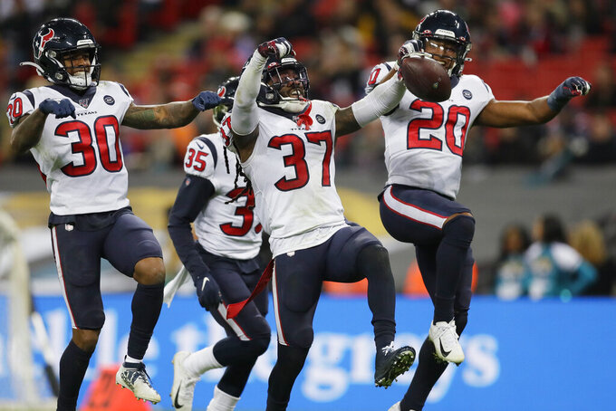 Houston Texans strong safety Jahleel Addae (37) celebrates his interception with teammates against the Jacksonville Jaguars during the second half of an NFL football game at Wembley Stadium, Sunday, Nov. 3, 2019, in London. (AP Photo/Kirsty Wigglesworth)