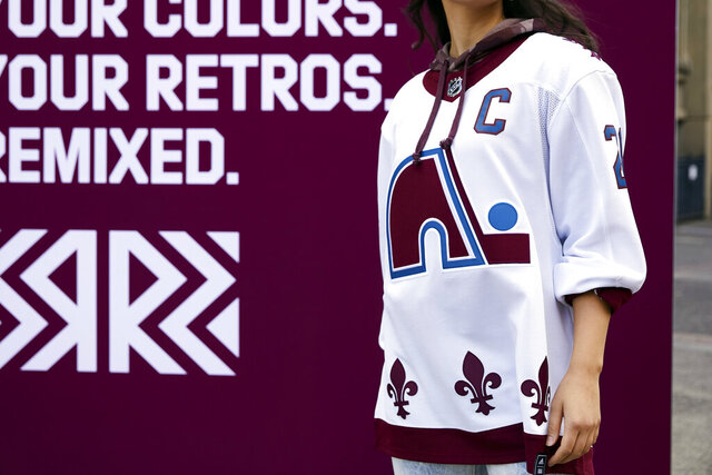 """This undated photo provided by Adidas shows the Colorado Avalanche's newest NHL hockey jersey featuring the logo and design of the Quebec Nordiques, which the team was known as until moving to Denver in 1995. The NHL and Adidas on Monday, Nov. 16, 2020, unveiled a """"Reverse Retro"""" jersey for all 31 teams, a way to spark interest before the next season begins. (Courtesy of Adidas via AP)"""