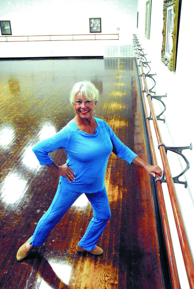 In this July 28, 2020 photo, Maciolek School of Dance owner and founder Karen Salb poses in her Hobbs, N.M. studio. She says the time has come to hand off dance instruction to the next generation and she's closing her studio after 50 years. (Blake Ovard/The Hobbs Daily News-Sun via AP)