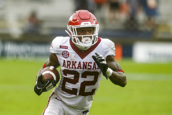 FILE - Arkansas running back Trelon Smith (22) carries the ball against Auburn during the second quarter of an NCAA college football game in Auburn, Ala., in this Saturday, Oct. 10, 2020, file photo. When Rakeem Boyd left the team after a 63-35 loss to Florida, Smith owned the starting job. He hasn't come to close to giving away the job in the fall after finishing 2020 with 710 yards and five touchdowns on 134 carries. (AP Photo/Butch Dill, File)