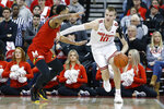 Ohio State's Justin Ahrens, right, controls the ball as Maryland's Eric Ayala defends during the first half of an NCAA college basketball game Sunday, Feb. 23, 2020, in Columbus, Ohio. (AP Photo/Jay LaPrete)
