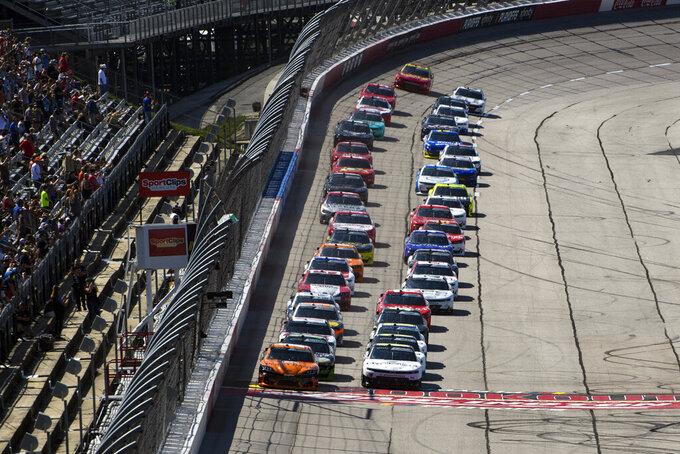 Daniel Hemric, left, and AJ Allmendinger, right, lead as a NASCAR Xfinity Series auto race starts, Saturday, Sept. 4, 2021, in Darlington, S.C. (AP Photo/John Amis)