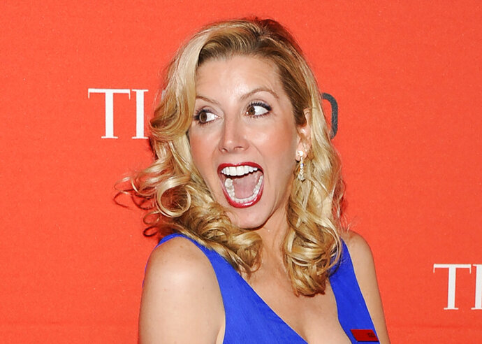 """FILE - In this April 24, 2012 file photo, Spanx founder Sara Blakely attends the TIME 100 gala, celebrating the 100 most influential people in the world, at the Frederick P. Rose Hall  in New York.  Blakely was the successful bidder for the skintight satin pants that Olivia Newton-John wore in the movie """"Grease."""" She  told """"CBS This Morning"""" Tuesday, Nov. 5, 2019 she plans to frame them and hang them at Spanx because they inspired the company's black faux-leather leggings.  (AP Photo/Evan Agostini, File)"""