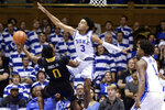 Duke guard Tre Jones (3) jumps to block Winthrop guard Russell Jones Jr. (0) during the second half of an NCAA college basketball game in Durham, N.C., Friday, Nov. 29, 2019. (AP Photo/Gerry Broome)