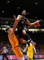 Nevada forward Caleb Martin (10) is fouled by New Mexico's Vladimir Pinchuk, left, of Germany, during the first half of an NCAA college basketball game in Albuquerque, N.M., Saturday, Jan. 5, 2019. (AP Photo/Andres Leighton)