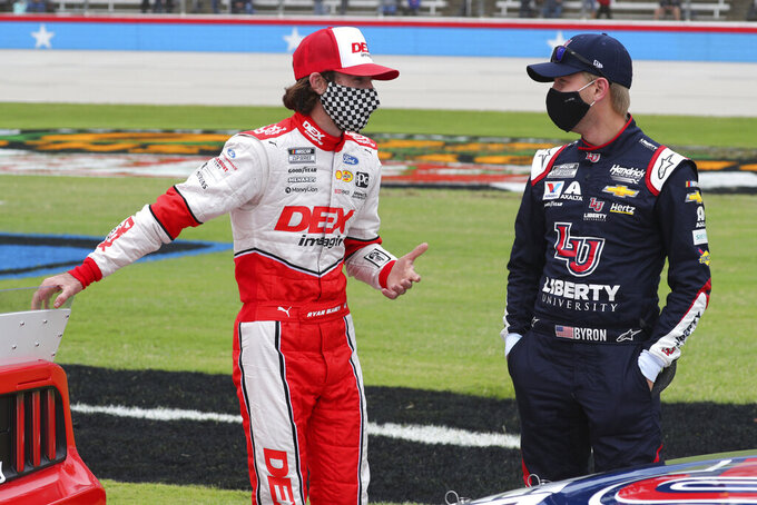 Ryan Blaney (12) talks with William Byron (24) as they wait on the grid before a NASCAR Cup Series auto race at Texas Motor Speedway in Fort Worth, Texas, Sunday, Oct. 25, 2020. (AP Photo/Richard W. Rodriguez)