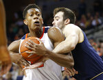 Virginia guard De'Andre Hunter (12) is fouled by Notre Dame forward John Mooney (33) during the second half of an NCAA college basketball game in Charlottesville, Va., Saturday, Feb. 16, 2019. Virginia beat Notre Dame 60-54. (AP Photo/Steve Helber)