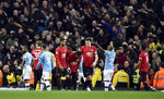 Players react to items thrown by Manchester City fans during the English Premier League soccer match between Manchester City and Manchester United at Etihad stadium in Manchester, England, Saturday, Dec. 7, 2019. (AP Photo/Rui Vieira)