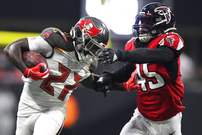 Tampa Bay Buccaneers running back Ronald Jones (27) runs agaimnst Atlanta Falcons linebacker Deion Jones (45) during the second half of an NFL football game, Sunday, Nov. 24, 2019, in Atlanta. (AP Photo/John Amis)