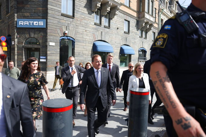 Sweden's Prime Minister Stefan Lofven, centre, before a confidence vote, with Minister for Gender Equality and Housing Marta Stenevi, left, and Minister for Finance Magdalena Andersson, right, as they arrive at the Swedish Parliament in Stockholm, Sweden, Monday June 21, 2021. Sweden's Prime Minister Stefan Lofven faces a no-confidence vote in the Riksdag parliament, after the Left Party said this week that it had lost confidence in Lofven and his center-left minority government. (Nils Petter Nilsson / TT via AP)