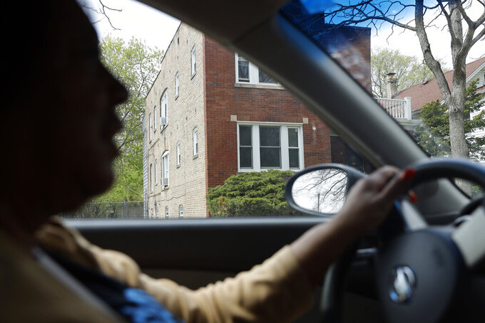 """Lifelong Evanston resident Jo-Ann Cromer parks outside her 5th Ward Evanston, Ill., home, where she has been living since the early 70s, on Thursday, April 29, 2021. The Chicago suburb is preparing to pay reparations in the form of housing grants to Black residents who experienced housing discrimination. Cromer plans on applying. """"Real estate represents wealth. I don't think people understand if Black people had been allowed to buy property, there would be a lot of wealthy Black people in Evanston,"""" Cromer said. """"There would be a path of wealth, generation to generation.""""  (AP Photo/Shafkat Anowar)"""