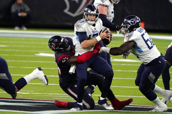 Tennessee Titans quarterback Ryan Tannehill (17) is sacked by Houston Texans defensive end Charles Omenihu (94) during the second half of an NFL football game Sunday, Jan. 3, 2021, in Houston. (AP Photo/Eric Christian Smith)