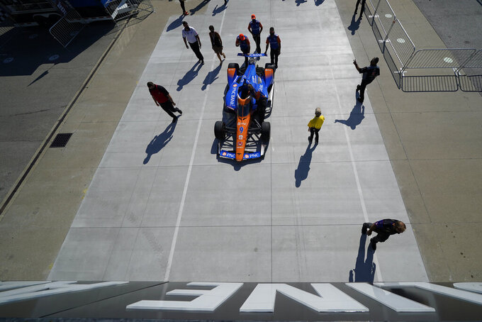 The car of Scott Dixon, of New Zealand, is pushed to pit lane for qualifications for the Indianapolis 500 auto race at Indianapolis Motor Speedway, Saturday, Aug. 15, 2020, in Indianapolis. (AP Photo/Darron Cummings)