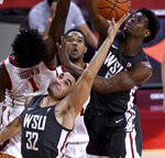Washington State's Tony Miller (32) reaches for a rebound next to Southern California's Chevez Goodwin (1) during the first half of an NCAA college basketball game in Los Angeles on Saturday, Jan. 16, 2021. (Keith Birmingham/The Orange County Register via AP)