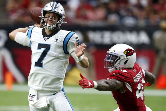Carolina Panthers quarterback Kyle Allen (7) throws as Arizona Cardinals outside linebacker Haason Reddick (43) pursues during the second half of an NFL football game, Sunday, Sept. 22, 2019, in Glendale, Ariz. (AP Photo/Ross D. Franklin)