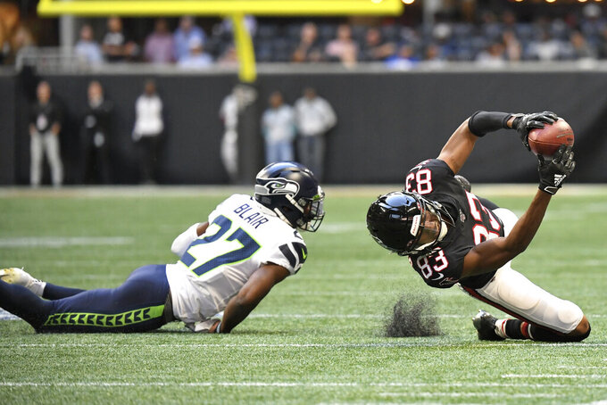 Atlanta Falcons wide receiver Russell Gage (83) makes the catch against Seattle Seahawks defensive back Marquise Blair (27) during the second half of an NFL football game, Sunday, Oct. 27, 2019, in Atlanta. The Seattle Seahawks won 27-20. (AP Photo/Danny Karnik)