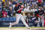 Washington Nationals' Trea Turner hits a home run during the first inning of a baseball game against the San Diego Padres, Monday, July 5, 2021, in San Diego. (AP Photo/Gregory Bull)