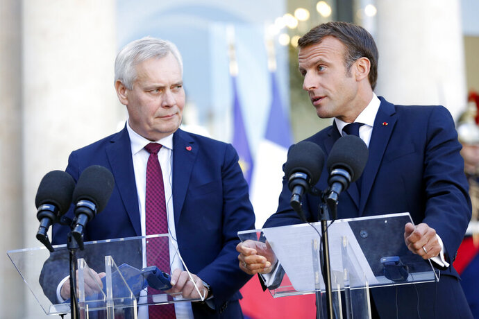 France's President Emmanuel Macron, right, and Prime Minister of Finland Antti Rinne, give a speech prior to a meeting, at the Elysee Palace, in Paris, Wednesday, Sept. 18, 2019. (AP Photo/Thibault Camus)