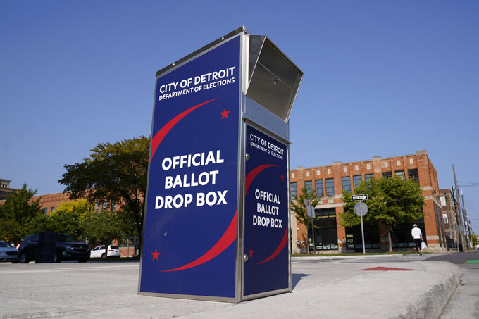 FILE - In this Thursday, Sept. 24, 2020, file photo, a ballot drop box is shown where voters can drop off absentee ballots instead of using the mail outside the Detroit Pistons training facility in Detroit. NFL, NBA, NHL, Major League Baseball and college venues are serving various roles in unprecedented ways, including providing space for people to vote while social distancing on Election Day. (AP Photo/Paul Sancya, File)