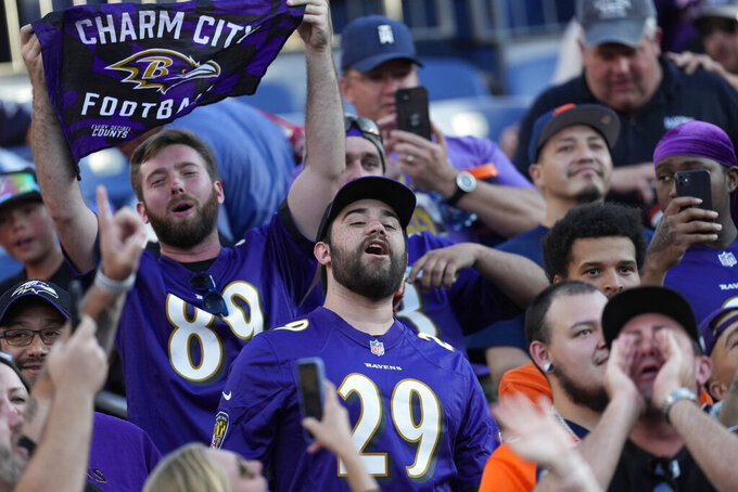 Baltimore Ravens fans cheer during the second half of an NFL football game against the Denver Broncos, Sunday, Oct. 3, 2021, in Denver. (AP Photo/David Zalubowski)