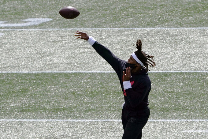 New England Patriots quarterback Cam Newton warms up before an NFL football game, Sunday, Sept. 13, 2020, in Foxborough, Mass. (AP Photo/Charles Krupa)
