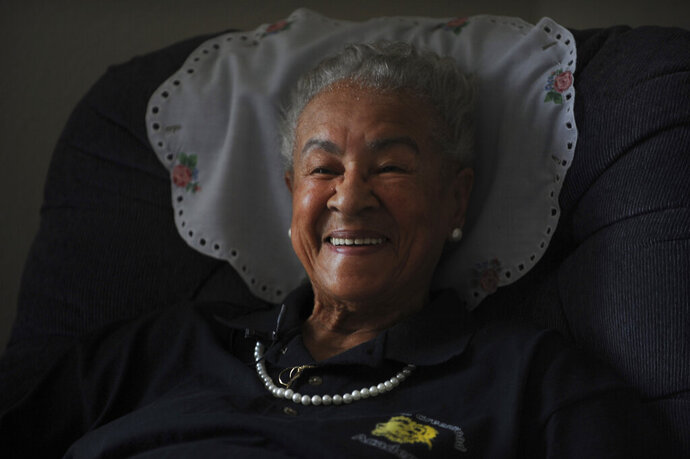 In this July 29, 2017 file photo Marie Greenwood recalls the time she spent at the Nizhoni camp for girls. Greenwood, a pioneering Denver teacher who devoted decades to fighting segregation in city institutions, has died. She was 106. Greenwood died on Friday, Nov. 15, 2019 at her Denver residence, said Elder Shane Stringfellow of Caldwell Kirk Mortuary. (Steve Nehf/The Denver Post via AP)